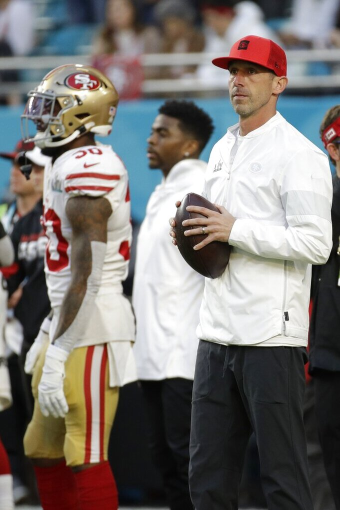 San Francisco 49ers head coach Kyle Shanahan watches before the NFL Super Bowl 54 football game between the San Francisco 49ers and Kansas City Chiefs Sunday, Feb. 2, 2020, in Miami Gardens, Fla. (AP Photo/Patrick Semansky)