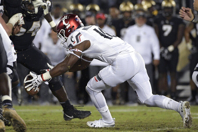 Cincinnati running back Charles McClelland (10) fumbles the ball during the second half of an NCAA college football game against Central Florida, Saturday, Nov. 17, 2018, in Orlando, Fla. Central Florida won, 38-13. (AP Photo/Phelan M. Ebenhack)