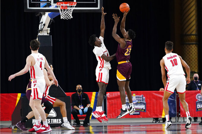 Iona's Nelly Junior Joseph (23) goes up for a shot against Fairfield's Supreme Cook (5) in the second half of an NCAA college basketball game during the finals of the Metro Atlantic Athletic Conference tournament, Saturday, March 13, 2021, in Atlantic City, N.J. (AP Photo/Matt Slocum)