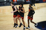 Oregon State's Zach Reichle (11), from left, Ethan Thompson (5) and Warith Alatishe (10) celebrate after defeating Colorado in an NCAA college basketball game in the championship of the Pac-12 men's tournament Saturday, March 13, 2021, in Las Vegas. (AP Photo/John Locher)