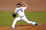 Los Angeles Dodgers starting pitcher Clayton Kershaw throws to a Milwaukee Brewers batter during the third inning in Game 2 of a National League wild-card baseball series Thursday, Oct. 1, 2020, in Los Angeles. (AP Photo/Ashley Landis)