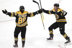 Boston Bruins right wing David Pastrnak (88) celebrates his goal against the Winnipeg Jets with Sean Kuraly during the first period of an NHL hockey game Thursday, Jan. 9, 2020, in Boston. (AP Photo/Elise Amendola)
