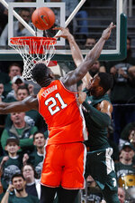 Michigan State's Xavier Tillman, right, attempts to dunk against Illinois' Kofi Cockburn (21) during the first half of an NCAA college basketball game Thursday, Jan. 2, 2020, in East Lansing, Mich. (AP Photo/Al Goldis)
