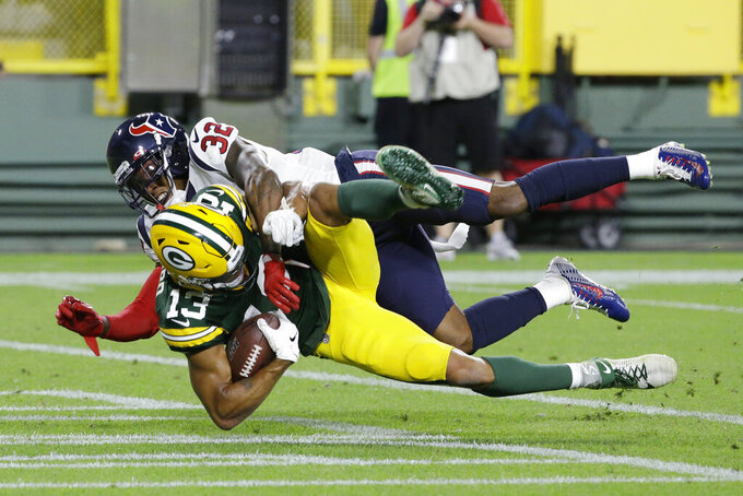Green Bay Packers wide receiver Allen Lazard catches a pass for a touchdown while being defended by Houston Texans cornerback Lonnie Johnson during the second half of an NFL preseason football game Thursday, Aug. 8, 2019, in Green Bay, Wis. (AP Photo/Mike Roemer)