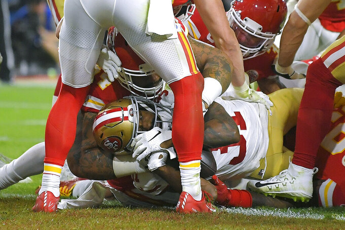 San Francisco 49ers' Raheem Mostert dives across the goal line for a touchdown against the Kansas City Chiefs during the second half of the NFL Super Bowl 54 football game Sunday, Feb. 2, 2020, in Miami Gardens, Fla. (AP Photo/Mark J. Terrill)