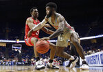 Houston's Corey Davis Jr., right, drives around Ohio State's C.J. Jackson during the second half of a second round men's college basketball game in the NCAA Tournament Sunday, March 24, 2019, in Tulsa, Okla. Houston won 74-59. (AP Photo/Jeff Roberson)