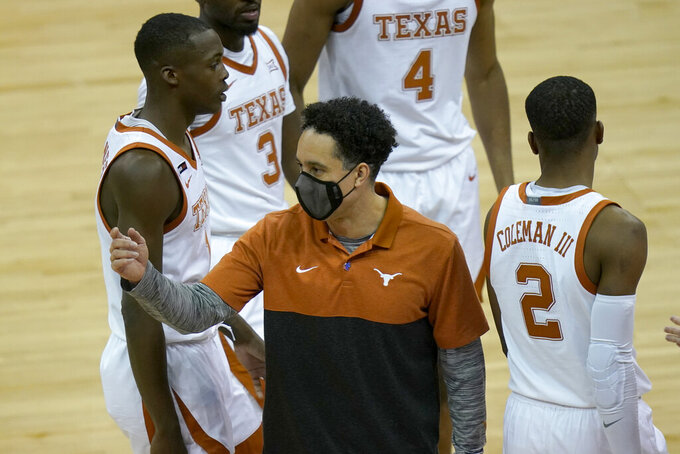 Texas head coach Shaka Smart gathers his team during a timeout in the second half of an NCAA college basketball game against Texas Tech in the quarterfinal round of the Big 12 men's tournament in Kansas City, Mo., Thursday, March 11, 2021. (AP Photo/Orlin Wagner)