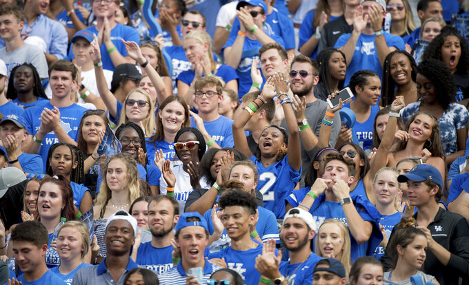 Kentucky fans celebrate a touchdown during an NCAA college football game against Central Michigan in Lexington, Ky., Saturday, Sept. 1, 2018. (AP Photo/Bryan Woolston)