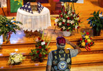 In this Thursday, Sept. 16, 2021, photo, David Gibbs Sr. salutes during the public visitation for Marine Cpl. Daegan Page at St. Paul Lutheran Church in Omaha, Neb. Gibbs, a Navy veteran, served 26 years. Cpl. Page was one of 13 U.S. service members killed Aug. 26 in a suicide bombing at the Kabul airport during the U.S. evacuation from Afghanistan. (Chris Machian/Omaha World-Herald via AP)