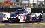 CORRECTS TO ALONSO NOT ALONZO - Fernando Alonso, of Spain, co-driver of the United Autosports Ligier LMP2 takes laps during testing for the IMSA 24 hour auto race at Daytona International Speedway, Friday, Jan. 5, 2018, in Daytona Beach, Fla. (AP Photo/John Raoux)