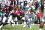 Coastal Carolina quarterback Kilton Anderson (7) attempts to escape South Carolina defensive lineman Javon Kinlaw (3) during the first half of an NCAA college football game Saturday, Sept. 1, 2018, in Columbia, S.C. (AP Photo/Sean Rayford)