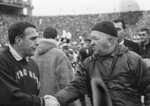 FILE - In this Nov. 19, 1966, file photo, Notre Dame football coach Ara Parseghian, left, shakes hands with Michigan State coach Duffy Daugherty after their 10-10 tie in East Lansing, Mich. The game was a slog, most memorable for Irish coach Ara Parseghian playing it safe at the end without his injured starting quarterback and settling for a tie. (AP Photo/File)