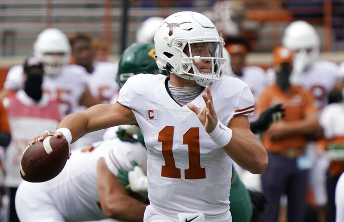 FILE - In this Oct. 24, 2020, file photo, Texas' Sam Ehlinger looks to pass against Baylor during the first half of an NCAA college football game in Austin, Texas. No. 15 Iowa State would reach the Big 12 championship game for the first time if can win at No.  20 Texas on Friday, Nov. 27, 2020. (AP Photo/Chuck Burton, File)