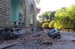 A damaged car outside the Faculty of Geology building after an earthquake in Tirana, Saturday, Sept. 21, 2019. Albania's government and news reports say an earthquake with a preliminary magnitude of 5.8 shook in the country's west and injured at least two people. (AP Photo)