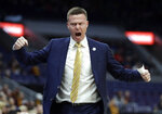 Valparaiso head coach Matt Lottich yells from the sidelines during the first half of an NCAA college basketball game against Loyola of Chicago in the quarterfinal round of the Missouri Valley Conference tournament, Friday, March 8, 2019, in St. Louis. (AP Photo/Jeff Roberson)