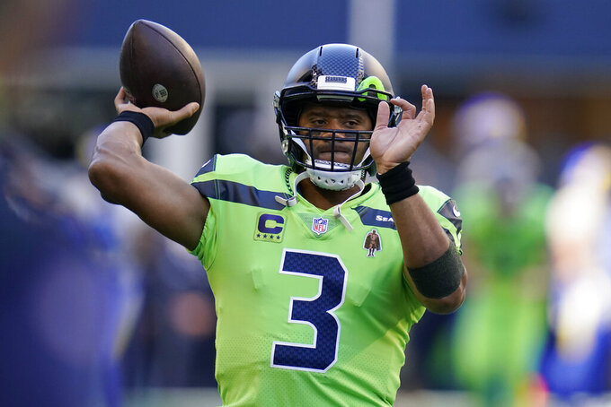 Seattle Seahawks quarterback Russell Wilson passes during warmups before an NFL football game against the Los Angeles Rams, Thursday, Oct. 7, 2021, in Seattle. (AP Photo/Elaine Thompson)