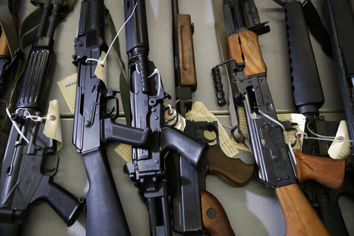 FILE - In this Oct. 9, 2018, file photo, Illegally possessed firearms seized by authorities are displayed during a news conference in Los Angeles. State authorities cleared 8.6% fewer cases last year into people who are no longer are allowed to own firearms, down from a record high in 2018, through a unique California program according to a California Department of Justice report released Wednesday, April 1, 2020. (AP Photo/Jae C. Hong, File)