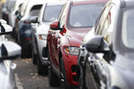 In this Nov. 10, 2019, photo a long row of unsold 2020 F-Pace sports-utility vehicles sits at a Jaguar dealership in Littleton, Colo. On Friday, Nov. 15, the Commerce Department releases U.S. retail sales data for October. (AP Photo/David Zalubowski)