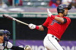 Cleveland Indians' Eddie Rosario watches his RBI-single in the fourth inning of a baseball game against the New York Yankees, Saturday, April 24, 2021, in Cleveland. (AP Photo/Tony Dejak)