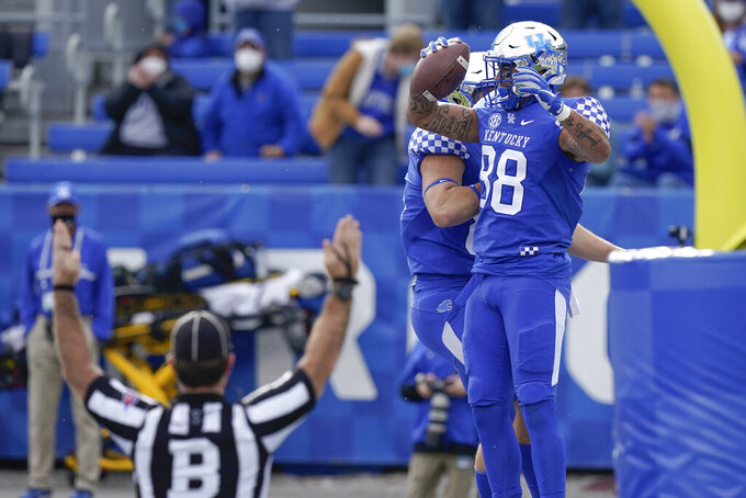 Kentucky tight end Keaton Upshaw (88) and tight end Justin Rigg (83) celebrate after Upshaw echoed a touchdown during the first half of an NCAA college football game against Vanderbilt, Saturday, Nov. 14, 2020, in Lexington, Ky. (AP Photo/Bryan Woolston)