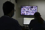 Medical staff monitor COVID-19 patients on CCTV screens at the intensive care unit of the Rafik Hariri University Hospital in Beirut, Lebanon, Friday, Jan. 22, 2021. Hospitals in Lebanon are reaching full capacity amid a dramatic surge in coronavirus cases across the crisis-hit Mediterranean nation even amid strict lockdown. (AP Photo/Bilal Hussein)