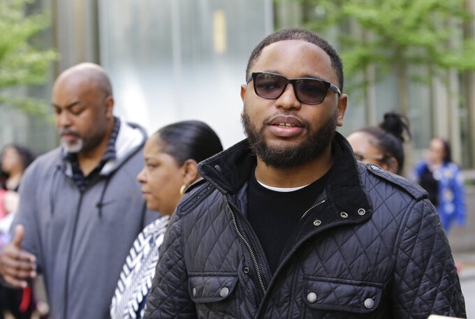 Christian Dawkins stands outside federal court Wednesday, May 8, 2019, in New York. Dawkins and and youth basketball coach Merl Code were convicted on a conspiracy count, but acquitted of some other charges. (AP Photo/Frank Franklin II)