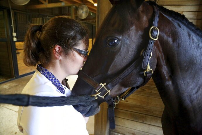 Kirsty Wright, 32, of Odessa, visits with her nine-year-old pony, Noelle, on Monday, Aug. 12, 2019, at Winding Oaks Equestrian Center in Masaryktown, Fla. Noelle was found in a wooded area in Jacksonville in 2017 and was adopted by Wright, a student, who has a goal to compete with Noelle in the Pony Finals. (Douglas R. Clifford/Tampa Bay Times via AP)