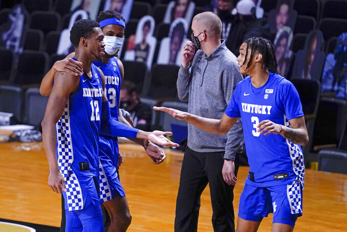 Kentucky's Keion Brooks Jr. (12), Isaiah Jackson (23) and Brandon Boston Jr. (3) leave the court after beating Vanderbilt in an NCAA college basketball game Wednesday, Feb. 17, 2021, in Nashville, Tenn. (AP Photo/Mark Humphrey)