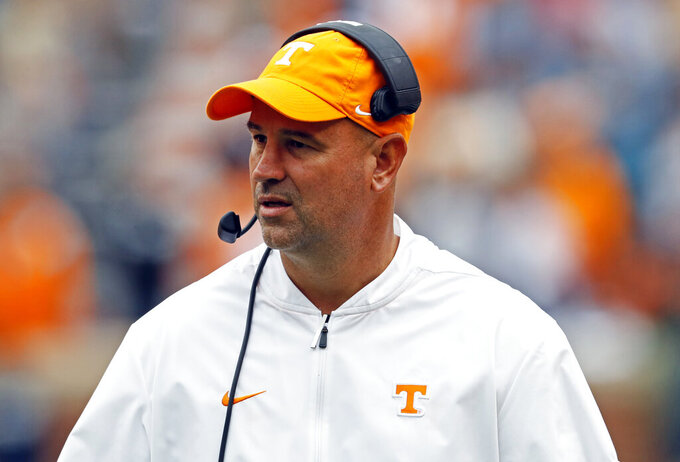 FILE - In this Oct. 12, 2019, file photo, Tennessee head coach Jeremy Pruitt watches during the second half of an NCAA college football game against Mississippi State, in Knoxville, Tenn. The third-year coach is embracing the virtual time he gets to work with his players following the go-ahead from the Southeastern Conference. He's also using social media to stay in touch with his current recruiting class and watching videos shot by his Vols of their personal workouts. (AP Photo/Wade Payne, File)