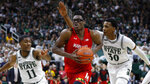 Maryland forward Jalen Smith (25) drives between Michigan State forward Aaron Henry (11) and Marcus Bingham Jr. (30) in the first half of an NCAA college basketball game in East Lansing, Mich., Saturday, Feb. 15, 2020. (AP Photo/Paul Sancya)