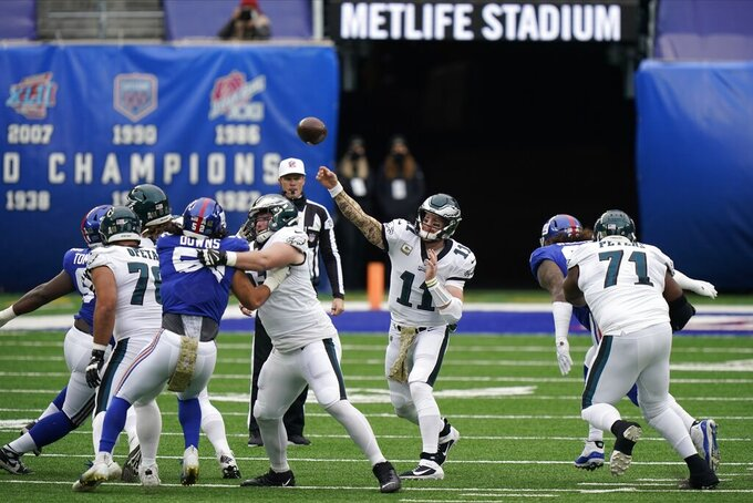 Philadelphia Eagles quarterback Carson Wentz (11) throws a pass during the first half of an NFL football game against the New York Giants, Sunday, Nov. 15, 2020, in East Rutherford, N.J. (AP Photo/Corey Sipkin)