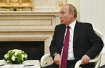 Russian President Vladimir Putin speaks with Israeli Prime Minister Benjamin Netanyahu during their meeting at the Kremlin in Moscow, Wednesday, July 11, 2018. (Yuri Kadobnov/ Pool photo via AP)