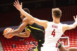 Oregon forward Shakur Juiston (10) drives to the basket as Washington State forward Aljaz Kunc (4) defends during the first half of an NCAA college basketball game Thursday, Jan. 16, 2020, in Pullman, Wash. (AP Photo/Pete Caster)