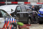The body of a lawyer who represented a key witness in a major Dutch organized crime trial is carried into a hearse after he was gunned down in Amsterdam, in Amsterdam, Netherlands, Wednesday, Sept. 18, 2019. Police said that 44-year-old lawyer Derk Wiersum was fatally shot Tuesday morning by a man who fled on foot and was still being hunted. (AP Photo/Peter Dejong)