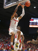 Dayton's Obi Toppin dunks during the first half of an NCAA college basketball game against St. Louis , Saturday, Feb. 8, 2020, in Dayton, Ohio. (AP Photo/Tony Tribble)