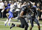 Vanderbilt defensive lineman Dayo Odeyingbo (10) runs the ball into the end zone for a touchdown after recovering a fumble by Middle Tennessee in the first half of an NCAA college football game Saturday, Sept. 1, 2018, in Nashville, Tenn. (AP Photo/Mark Humphrey)