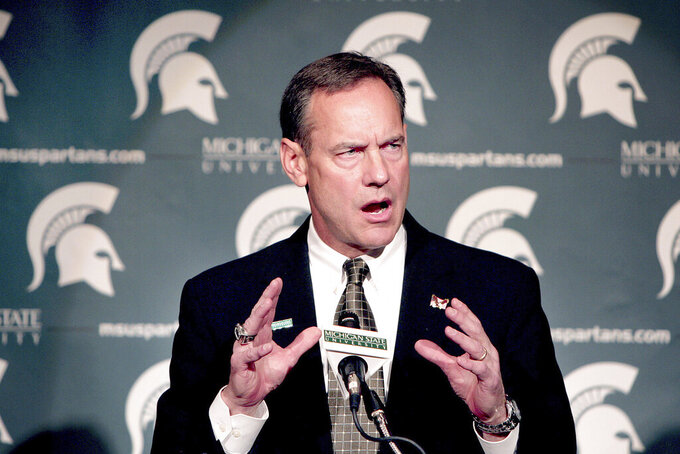 FILE - In this Nov. 27, 2006, file photo, Mark Dantonio speaks to the media after being named Michigan State's 24th head football coach at a press conference on campus in East Lansing, Mich. Dantonio announced his retirement Tuesday, Feb. 4, 2020, ending a 13-year run in which he guided the Spartans to heights they hadn't reached in decades.  (AP Photo/Daymon J. Hartley, File)