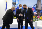 French President Emmanuel Macron, center, and French Foreign Minister Jean-Yves Le Drian greet Poland's President Andrej Duda during a bilateral meeting on the sidelines of a NATO summit at NATO headquarters in Brussels, Monday, June 14, 2021. U.S. President Joe Biden is taking part in his first NATO summit, where the 30-nation alliance hopes to reaffirm its unity and discuss increasingly tense relations with China and Russia, as the organization pulls its troops out after 18 years in Afghanistan. (AP Photo/Francois Mori, Pool)