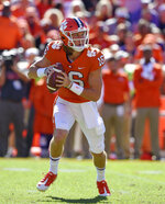 Clemson quarterback Trevor Lawrence scrambles out of the pocket during the first half of an NCAA college football game against Louisville, Saturday, Nov. 3, 2018, in Clemson, S.C. (AP Photo/Richard Shiro)