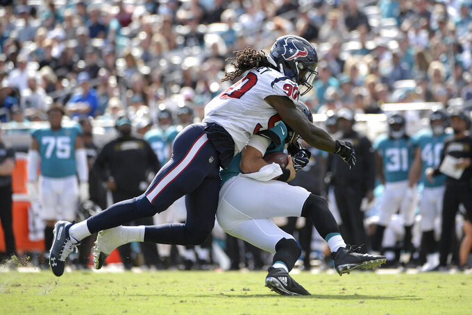 AP sources: Seahawks close to landing Clowney from Texans