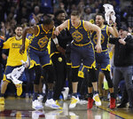 Golden State Warriors' Jonas Jerebko (21) celebrates a score with Stephen Curry, right, and Kevin Durant (35) during the first half of the team's NBA basketball game against the Chicago Bulls on Friday, Jan. 11, 2019, in Oakland, Calif. (AP Photo/Ben Margot)