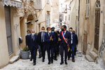 French president Emmanuel Macron, center, and Bonifacio Mayor Jean Charles Orsucci, right, visit Bonifacio, Corsica island, Thursday Sept.10, 2020. French President Emmanuel Macron urged fellow European leaders Thursday to stand up to Turkey's government and what he called
