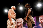 WBC Heavyweight Champion Tyson Fury, left and Deontay Wilder face off at a news conference in Los Angeles on Tuesday, June 15, 2021, in anticipation of their third heavyweight championship showdown scheduled for July 24 in Las Vegas. (AP Photo/Richard Vogel)