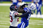 Indianapolis Colts wide receiver Zach Pascal (14) makes a catch under pressure from Houston Texans free safety Eric Murray (23) in the first half of an NFL football game in Indianapolis, Sunday, Dec. 20, 2020. (AP Photo/Darron Cummings)
