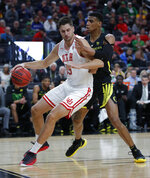 Utah's Novak Topalovic drives around Oregon's Kenny Wooten during the first half of an NCAA college basketball game in the quarterfinals of the Pac-12 men's tournament Thursday, March 14, 2019, in Las Vegas. (AP Photo/John Locher)