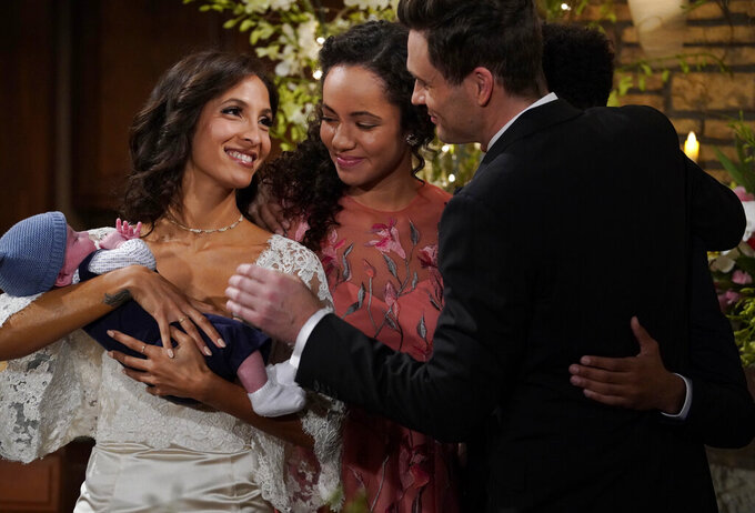 """This 2018 image released by CBS shows a scene from the daytime series """"The Young and the Restless."""" The series is scheduled to go back into production next week after halting due to the coronavirus epidemic. (Cliff Lipson/CBS via AP)"""
