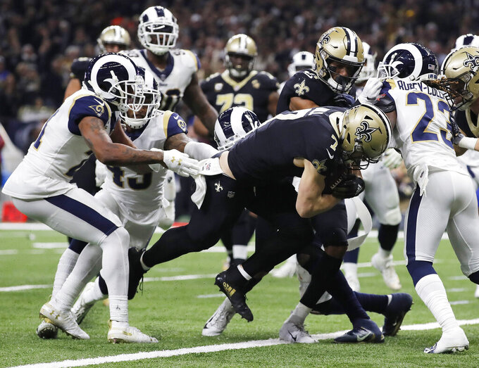 New Orleans Saints' Taysom Hill catches a touchdown pass during the second half of the NFL football NFC championship game against the Los Angeles Rams, Sunday, Jan. 20, 2019, in New Orleans. (AP Photo/Carolyn Kaster)