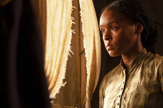 """This image released by Lionsgate shows Janelle Monae in a scene from """"Antebellum."""" The film, due out Aug. 21, 2020, from Lionsgate and starring singer and actress Monáe, will challenge audiences over the failure to reckon with the legacy of slavery, the directors say. (Matt Kennedy/Lionsgate via AP)"""