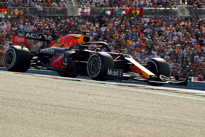 Red Bull driver Max Verstappen, of the Netherlands, races during the Formula One U.S. Grand Prix auto race at the Circuit of the Americas, Sunday, Oct. 24, 2021, in Austin, Texas. (AP Photo/Eric Gay)