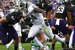 Michigan State running back Elijah Collins (24) runs for a touchdown as Northwestern linebacker Paddy Fisher (42) tries to tackle him during the first half of an NCAA college football game, Saturday, Sept. 21, 2019, in Evanston, Ill. (AP Photo/David Banks)